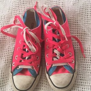 Hot pink and teal Converse.